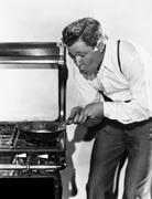 Portrait of man cooking on stove Stock Photos