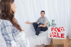 Man in his new house chatting with his wife - stock photo