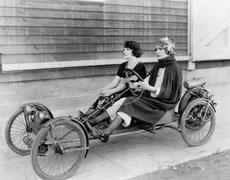 Two women in go kart Stock Photos