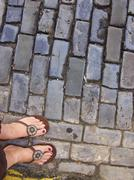Toes on brinks in Old San Juan Puerto Rico - stock photo