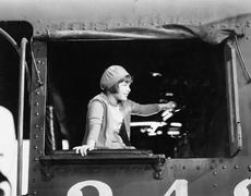 Little girl in a beret driving a train Stock Photos