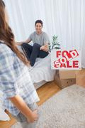 Man chatting with his wife in his new house - stock photo