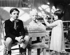Boy and girl in an artist studio Stock Photos