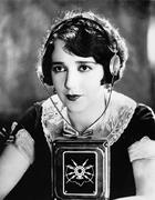 Woman wearing headphones with a microphone in front of her Stock Photos