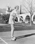 Woman playing badminton Stock Photos