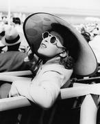 Woman in a big sun hat and sun glasses Stock Photos