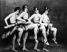 Portrait of four young women performing a dance Stock Photos