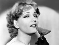 Portrait of a woman holding a martini glass Stock Photos