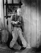 Drunken man holding a handgun - stock photo
