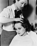 Young woman getting her hair done in a hair salon - stock photo