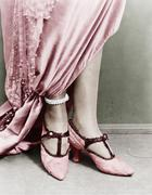 Low section view of a woman wearing shoes Stock Photos