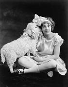 Lamb whispering into a teenager's ear - stock photo