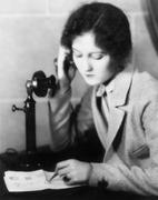 Close-up of a woman talking on the telephone and drawing on a sheet of paper Stock Photos
