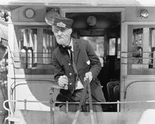 Conductor on a horse drawn streetcar holding the reins Stock Photos