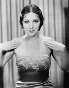 Woman showing her evening dress - stock photo
