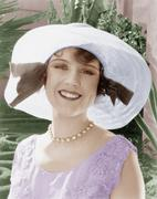 Woman in a wide brimmed hat smiling Stock Photos