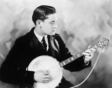 Man playing a banjo - stock photo