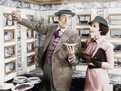 Man serving a dish to a woman in a Automat - stock photo