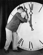 Man setting time on a big clock Stock Photos