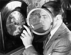 Man setting a clock Stock Photos