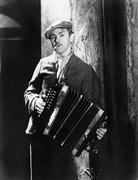 Man playing an accordion - stock photo