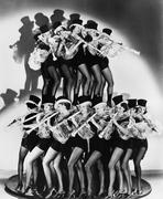 Women in costumes performing a clarinet concert Stock Photos