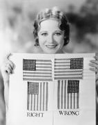 Young woman holding a diagram of how to hang an American Flag Stock Photos