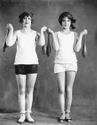 Two women exercising with juggling pins Stock Photos