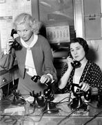 Two women working on a phone bank Stock Photos