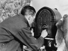 Man tuning the radio Stock Photos