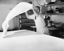 Baker throwing dough through the air Stock Photos