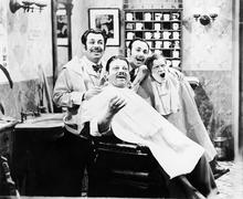 Group of four men at a barber shop singing - stock photo