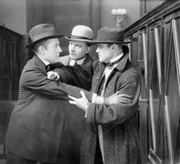 Three men arguing with each other Stock Photos