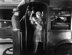 Young woman riding a bus flirting with a young man - stock photo