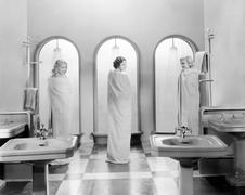 Three women in a bathroom together Stock Photos