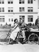 Couple riding tandem bike - stock photo