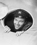 Sailor looking up through hole - stock photo