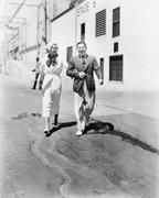 Couple walking together and laughing - stock photo