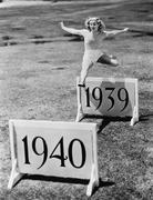 Woman jumping hurdles labeled with years Stock Photos