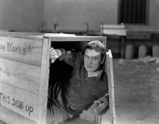 Man hiding in wooden crate - stock photo