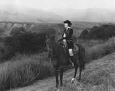 Horseback riding in the country Stock Photos