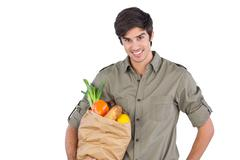 Stock Photo of Young man with shopping bag