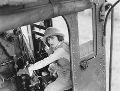 Woman hijacking train Stock Photos