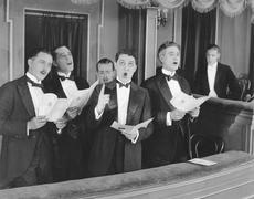 Men singing in choir - stock photo