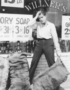 Worried man holding sack - stock photo