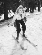 Woman on skiis with knees bent - stock photo