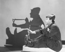 Man aiming slingshot Stock Photos