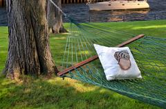 nautical pillow and hammock - stock photo