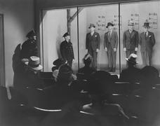 Police line up Stock Photos