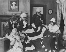 Admiring the Betsy Ross flag - stock photo